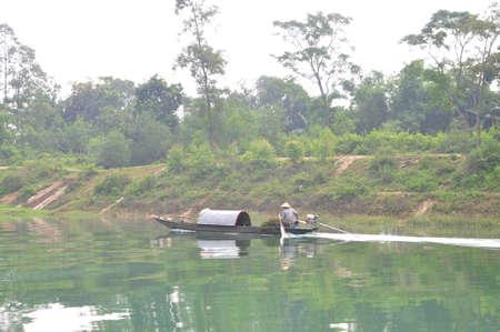 mugla: Quang Binh, Vietnam - October 23, 2015: Local fisherman are fishing with his small boat on the Trang An river