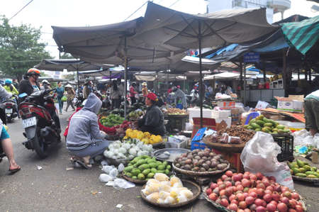 rushed: Nha Trang, Vietnam - February 7, 2016: Plenty of fruits and grocery are for sale in a street market in Vietnam Editorial