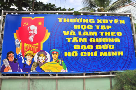 propaganda: Nha Trang, Vietnam - February 5, 2016: A propaganda poster which means Imitating Uncle Hos morality in Vietnam regularly.