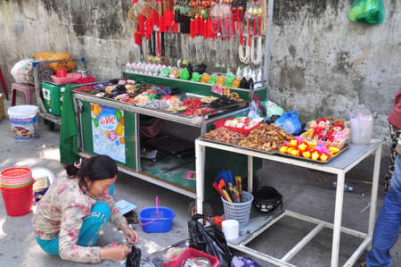 Nha Trang, Vietnam - February 7, 2016: People are buying things for worship in a pagoda on the first day of the lunar new year in Vietnam