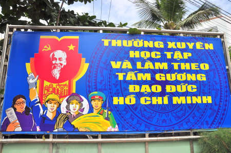 morality: Nha Trang, Vietnam - February 5, 2016: A propaganda poster which means Imitating Uncle Hos morality in Vietnam regularly.