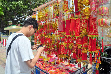laterns: Nha Trang, Vietnam - February 7, 2016: Red lanterns and lucky items are for sale in the lunar new year on the street of Vietnam