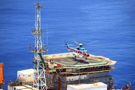 Vung Tau, Vietnam - May 17, 2016: A helicopter is landing on an oil rig in the sea of Vietnam