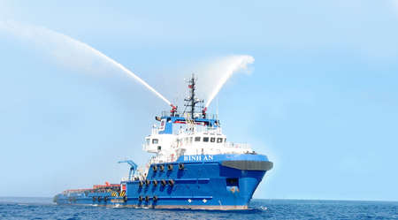 subsea: Vung Tau, Vietnam - May 29, 2016: An oil transportation ship  is blowing water in the sea Editorial