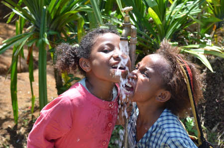 Papua New Guinea - October 25, 2015: Children are happy with water in a remote and difficult place in Papua New Guinea