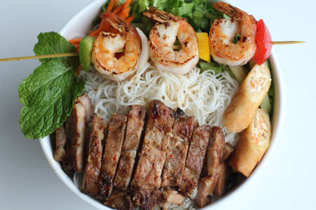 Bun thit nuong or grilled shrimp, beef, spring rolls vermicelli