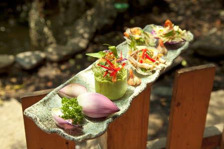 Vietnamese special salad of lotus, onion, shimp and squid or goi ngu sac