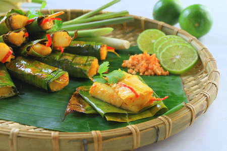 cuon: Vietnamese steamed rice pancake with shrimp on tray with banana leaf Stock Photo