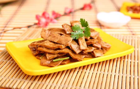 spanferkel: Fried sliced duck meat on yellow plate on the table in restaurant