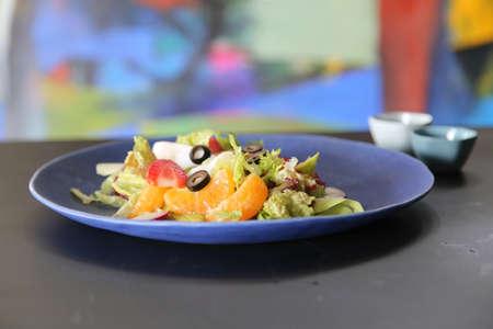 Vietnamese salad of orange, strawberry and vegetables Stock Photo