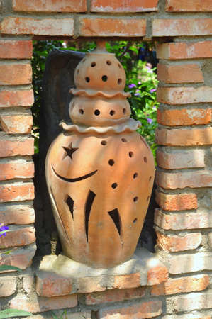 alibaba: Old champa vase or lamp on a fence