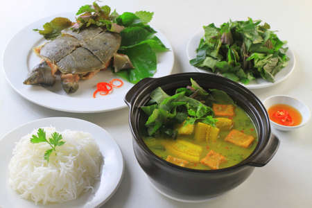 Stewed turtle softshells with herbs, banana soup and vermicelli