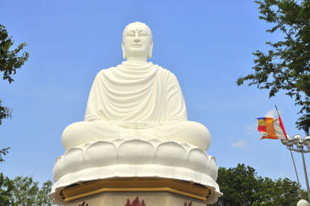 in monastery: White big statue of Buddha