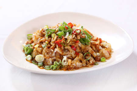 Minced pork with onion on white plate