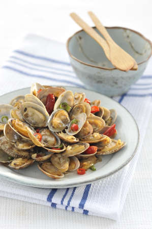 Fried clams on white plate in the restaurant