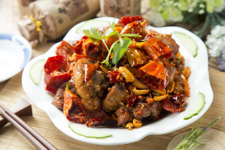 Spicy chinese braised pork on white plate Reklamní fotografie - 62985528