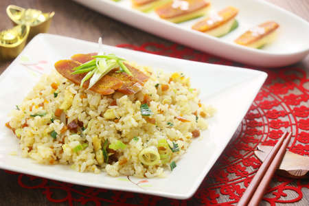 Fried rice with chinese sliced sausages on white plate Stock Photo