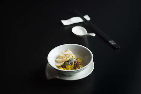 Meepok seafood in white bowl