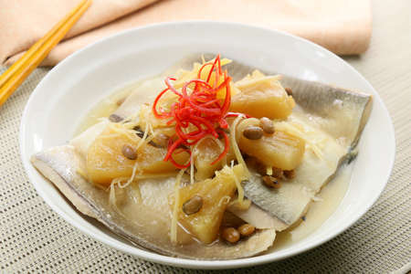 Sauce of milkfish with braised pineapple and sliced chili on white plate