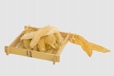 Dried peanut worm or sipunculus nudus on bamboo tray in white background Stock Photo