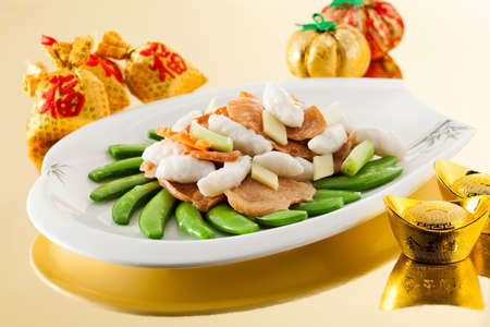 sensations: Sensations sauteed mashed cuttlefish with sugar peas fungus Stock Photo