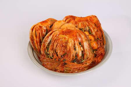 Korean cabbage kimchi on plate on white background