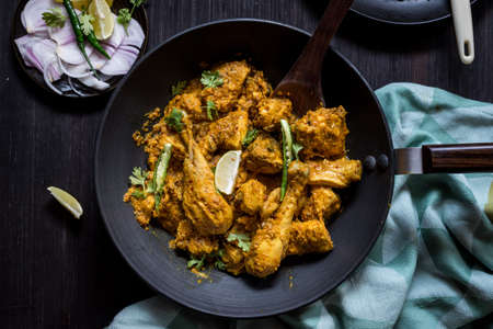 Zero oil indian chicken curry in black pan on the table