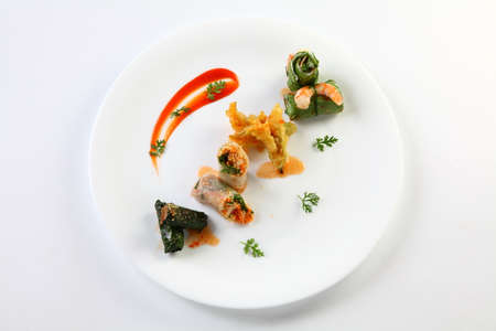 nem: Vietnamese spring rolls on white plate with herbs