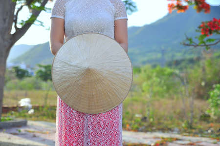 Vietnamese long dress with traditional leaf hat