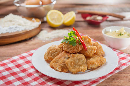 Plate of fried breaded pork on the table in restaurant