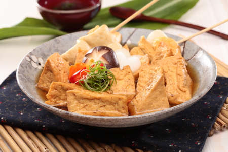 Sue fried fish paste tofu soup with mushroom and onion on chinese plate Stock Photo