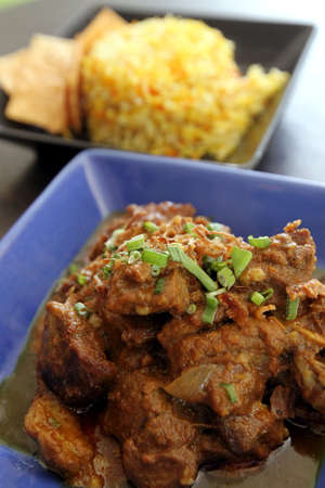 The Mutton Curry features tender mutton and potato curry served with mango salad and briyani rice