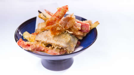 flavorful: Vegetable tempura on blue chinese plate on white background