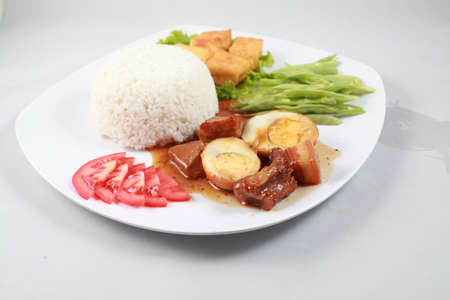 rou: Plain rice with braised pork with egg in Vietnam Stock Photo