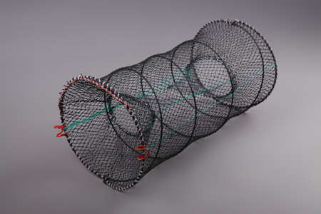 fishing tackle: Harvest gear of round grid for fishing tackle on grey background