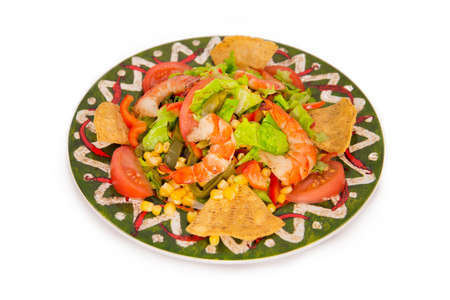 Mexican style of salads with shrimps, salmon, lemon and lettuce on white background