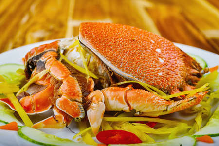 Steamed king crab on white plate in restaurant Stock Photo