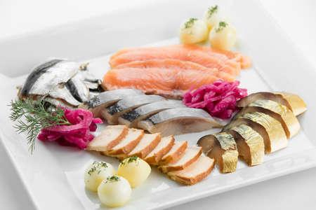Fish plateau with tuna, salmon, mashed potato anf toast on white plate Stock Photo