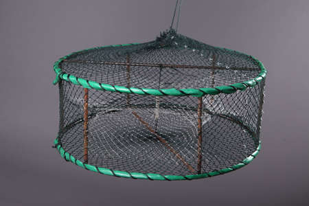 trawl: Harvest gear of fixed disk-type crab cages  with three entrance on grey background Stock Photo