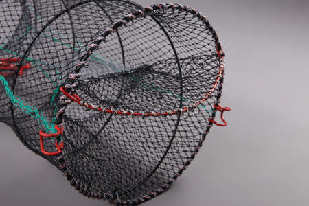 trawl: Harvest gear of Eel cylindrical cage on grey background