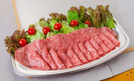 Soft salami platter of ham bacon with tomatoes and lettuce in lunch box