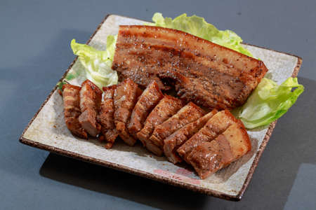 chinese meal: The plate of Hakka dishes pepper bacon with lettuce on grey background