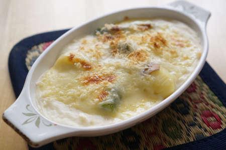 Hokkaido asparagus potato gratin on white bowl Stockfoto