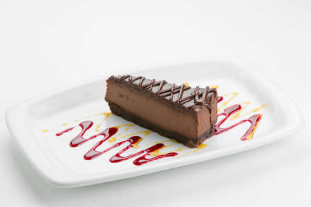 cheese cake: Chocolate cheese cake on white plate with sauce Stock Photo
