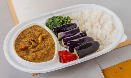 rajma: Lunch box of fried eggplant, spinach, curry with chili and plain rice