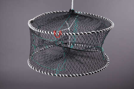 trawl: Harvest gear of round grid for fishing tackle on grey background