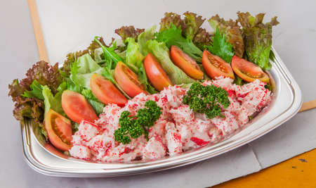 Mashed Crab flavor salad platter with tomatoes and lettuce in lunch box Stock Photo