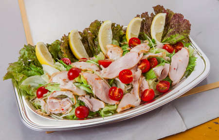 Marinated Smoked Chicken with lemon, tomatoes and lettuce in lunch box