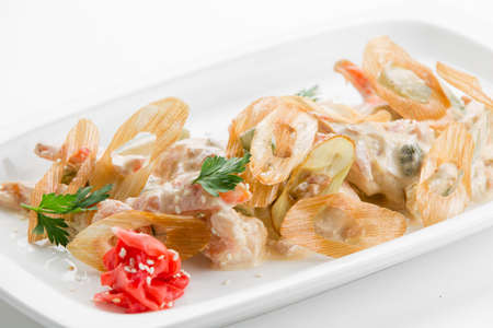 Sauteed tiger prawns in a sauce Ber Blanc on white plate background Stock Photo