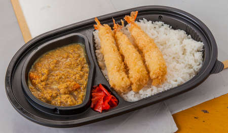 rajma: Fried shrimp curry with fried tempura, chili and plain rice in bento box Stock Photo